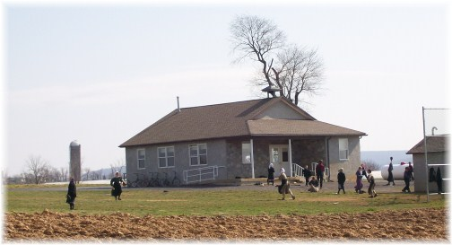 Amish children playing baseball