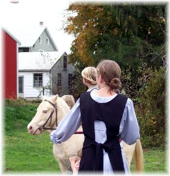 Amish children watching balloon