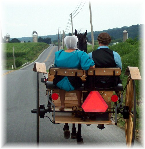 Amish couple riding to youth meeting