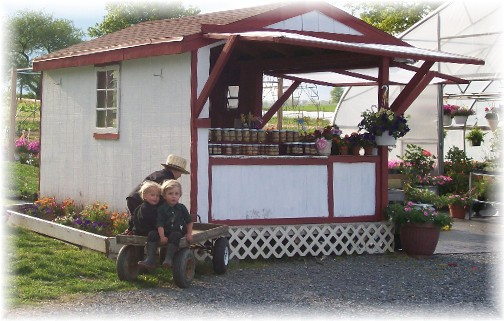 Creekside greenhouse (children on wagon)