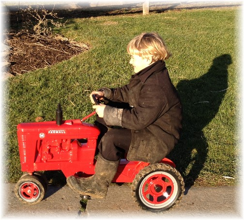 Eli James on FarmAll tractor 12/25/14