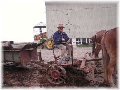 Jim Schmidt on manure spreader