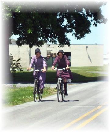 Old order Mennonite girls on bikes 6/2/11