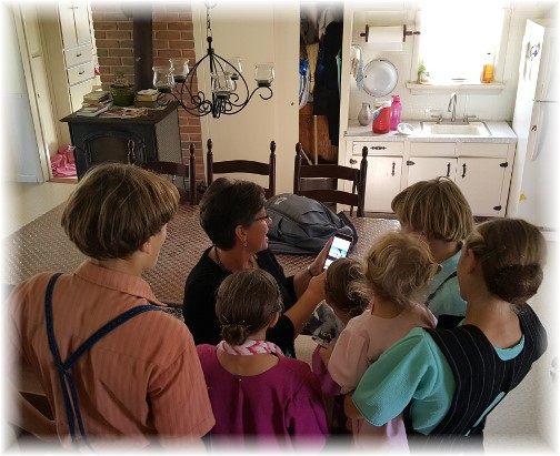 Sharing photos with children on the Old Windmill Farm 10/22/17