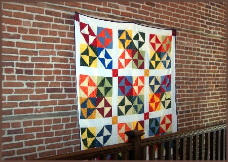 Quilt on brick wall