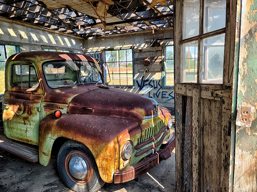 Truck in Jackson's Garage, Bridgeport, Nebraska (Photo by Howard Blichfeldt)