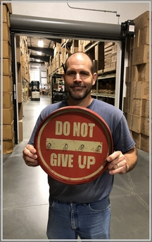 "Jason holding ""Do Not Give Up"" sign 10/2/18"
