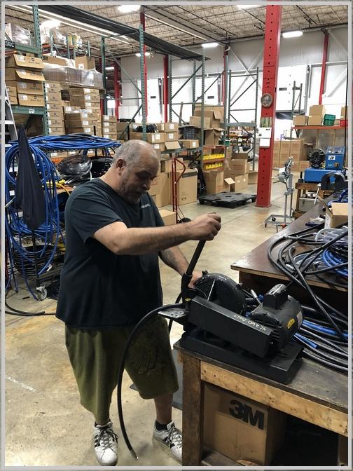 Luis making hoses