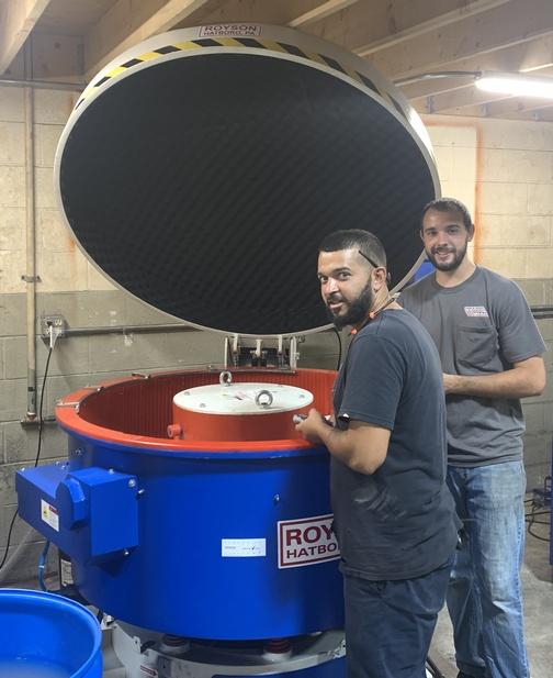 Anthony and Derek at vibratory tumbling machine