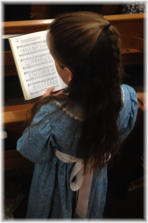 Child singing from hymnal 09-28-14
