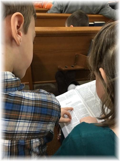 Children reading Bible