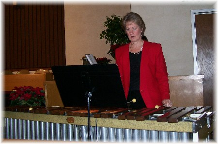 Lu playing the Marimba