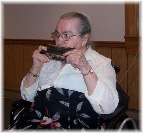 Naomi Wolgemuth playing harmonica