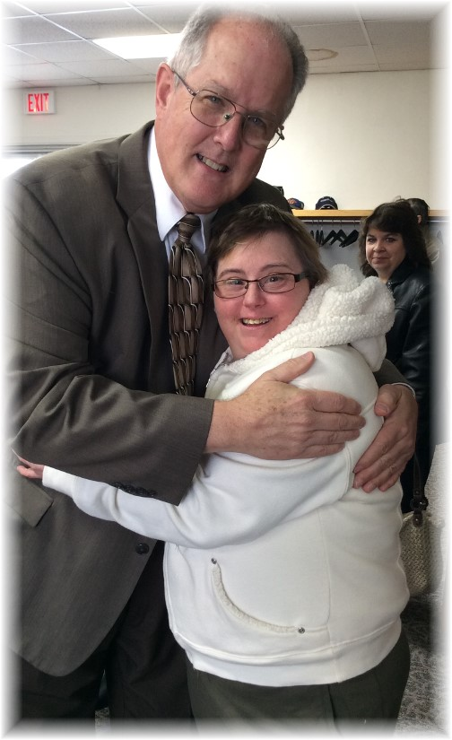 Pastor Keefer hugging Connie