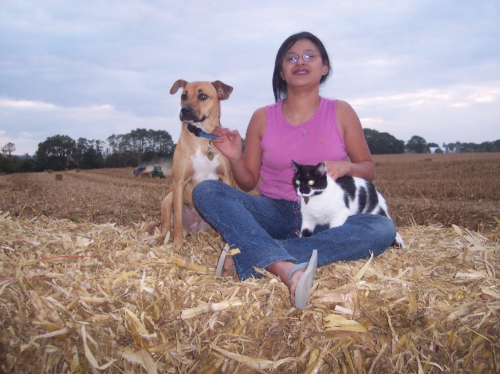 Ester on bale with our pets