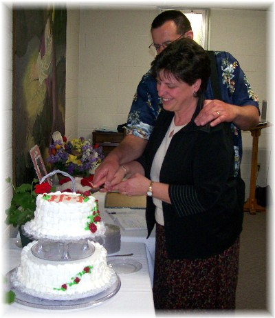 Cutting the cake together at our 33rd anniversary party
