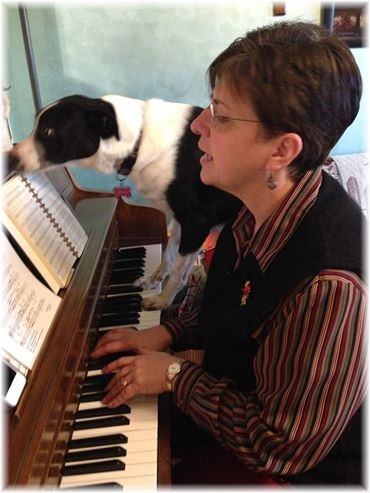 Brooksyne playing piano with Mollie
