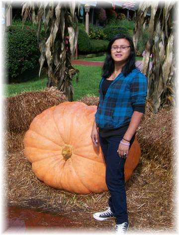 Ester with 602 pound pumpkin at the Yankee Candle flagship store, South Deerfield, MA