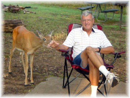 Richard Mayberry with Lucy, a friendly deer