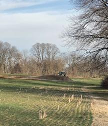 Manure drag line tractor