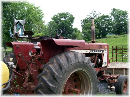 Farmall tractor with child safety seat