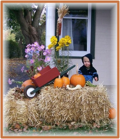 David with autumn decoration at the Pierce home