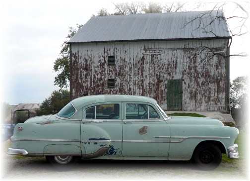 1953 Pontiac sedan and barn