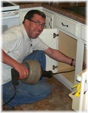 Ken Pierce clearing drain line
