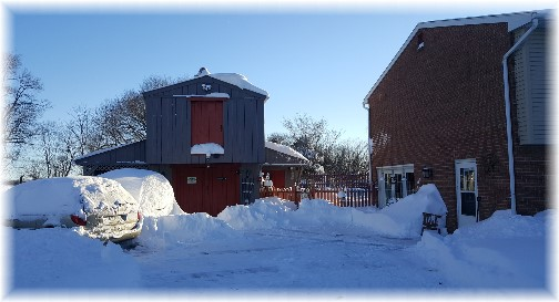 View of vehicles and barn following snow storm 1/24/16