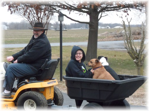 Stephen and Ester with pets on lawn tractor 2/22/13