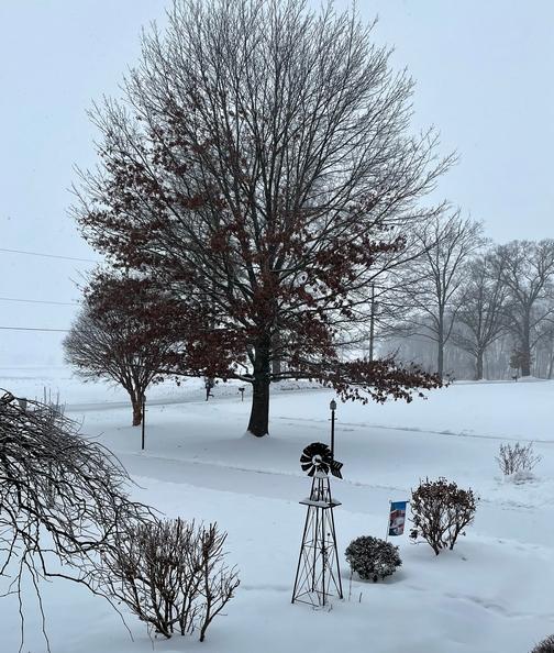 Windmill on snowy day