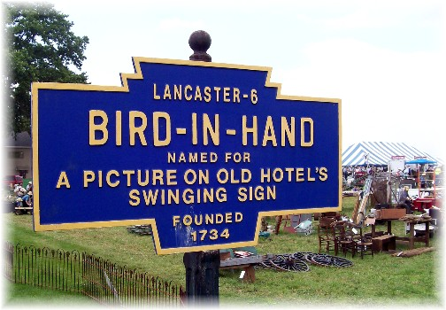 Bird-In-Hand road sign at the Lancaster County Carriage & Antique Auction in Bird In Hand PA.