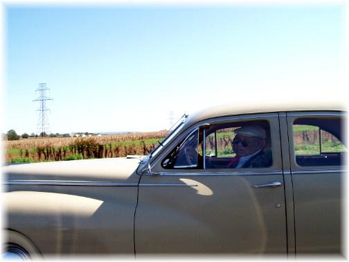 Dapper couple in old car