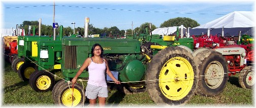 Ester with tractor display at 2011 E-town fair