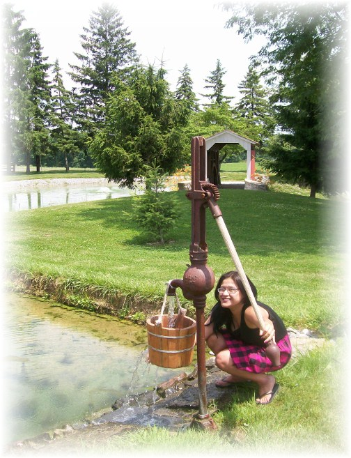 Ester by water pump at Longenecker farm in Lancaster County PA