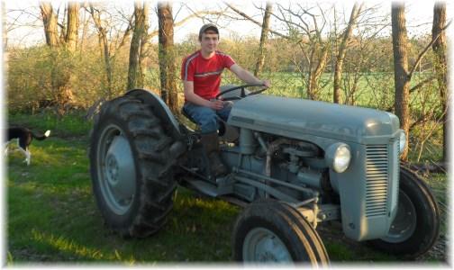 Riding great-grandpa's tractor 4/13/13
