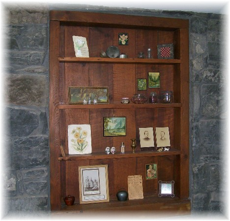 Shelves built into stone wall