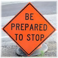 """Be prepared to stop"" sign"