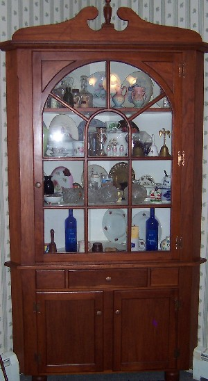 Cherry corner cabinet made by Raymond McGallicher