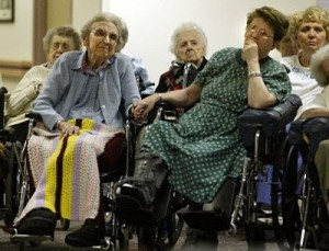 Residents at a nursing home chapel service