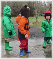 Children playing in puddles