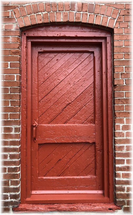 Red painted door at Kleen-Rite
