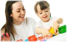 Teacher and little girl fingerpainting