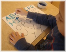 Child tracing letters