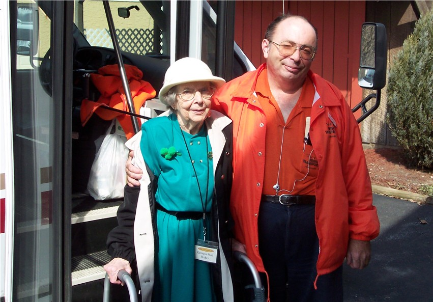 Photo of Mom and her senior center bus driver last October