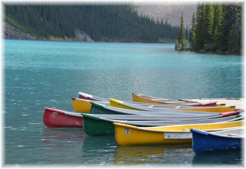 Canoes on mountain lake (Doris High)