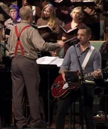 Red suspender choir director