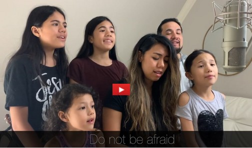 Family singing Scripture song