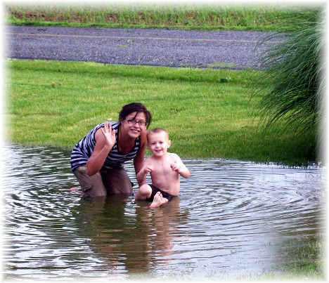 Ester and David playing in pond following Memorial Day storm 5/31/10