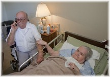 Elderly couple (husband caring for wife who had stroke)